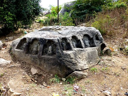Barabar Caves - Lingas Carved in Rock (9227549322).jpg
