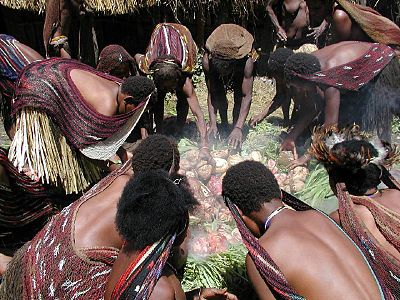 Christmas in Papua is marked with Barapen (grilling stone). Barapen Ceremony Baliem Valley.jpg