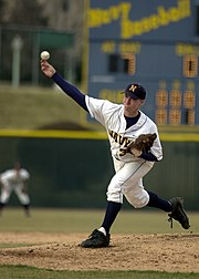 A pitcher releases the baseball from the pitcher's mound