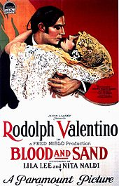 Film poster showing a stylised image of Rudolph Valentino with a woman in her arms, They appear to be about to kiss, or have just kissed. The film's name and other details are shown at the bottom.