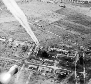 Operation Windsor - Rockets fired from a Hawker Typhoon of No 181 Squadron, RAF, at buildings on Carpiquet airfield. The 3rd Canadian Division took Carpiquet on 4 July.