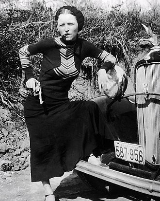 "Bonnie and Clyde - Parker's playful pose with a cigar branded her in the press as a ""cigar-smoking gun moll"" when police found the undeveloped film in the Joplin hideout"