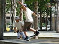Boy performing a skateboard wheelie, Barcelona, Spain.jpg