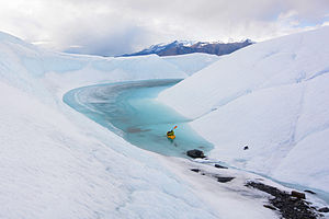 Packraft - A packrafter enters an ice canyon on Matanuska Glacier, Alaska.