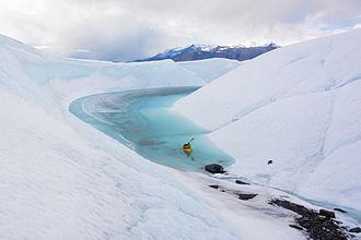 Packraft - A packrafter enters an ice canyon on Matanuska Glacier, Alaska.