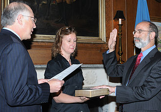 Minerals Management Service - Secretary of the Interior Ken Salazar swears in Michael Bromwich as the new director of the Bureau on June 21, 2010. Betsy Hildebrandt, Department of Interior Communications Director holds the Bible.