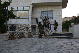 2014 kidnapping and murder of Israeli teenagers - IDF troops entering a building to search on 15 June.