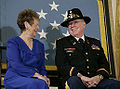 Bruce Crandall and wife with MOH flag.jpg