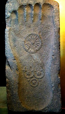 stone footprint Gautama Buddha with Dharmachakra and Three Jewels