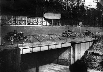 Autodromo Nazionale Monza - A race in 1925 with cars racing across the bridge.