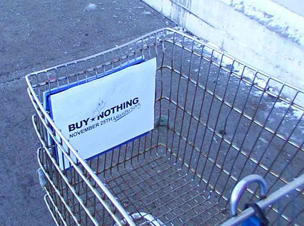 A Buy Nothing Day sign attached to a Walmart shopping trolley by an activist Buy Nothing Day trolley (cropped).jpg