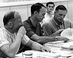 Buzz Aldrin (left), Mike Collins, and Neil Armstrong review flight plans.jpg