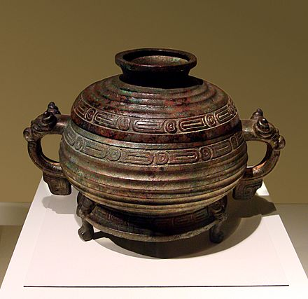 A Western Zhou ceremonial bronze of cooking-vessel form inscribed to record that the King of Zhou gave a fiefdom to Shi You, ordering that he inherit the title as well as the land and people living there CMOC Treasures of Ancient China exhibit - bronze gui.jpg