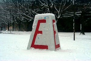 Engineering Undergraduate Society of the University of British Columbia - The Cairn painted with a large red 'E' for engineering
