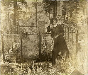 Calamity Jane - Calamity Jane at Wild Bill Hickok's Gravesite, Deadwood, Dakota Territory.