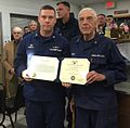 Capt. Richard Schultz, sector commander of Sector Southeastern New England, presents Jack Cowley with the Coast Guard Auxiliary Achievement Medal.jpg