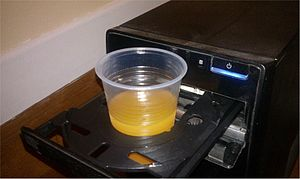 Cup holder - CD reader used as a cup holder