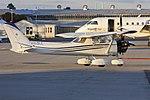 Cessna 150M (VH-SLL) being towed at Wagga Wagga Airport.jpg