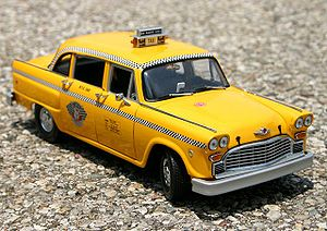Metal die-cast model of a Checker taxicab