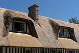 Chimney windows thatched roof Normandy.jpg
