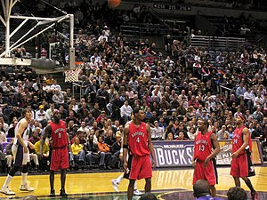 Chris Bosh - Bosh and his teammates in a 2005–06 game against the Milwaukee Bucks. From left: Pape Sow, Bosh, Mike James and Morris Peterson.
