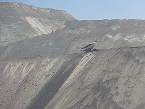 Chuquicamata - Mine's waste rock dumped by a giant truck