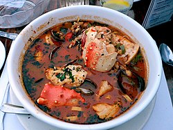 Cioppino is a fish stew originating in San Francisco, California. It is considered an Italian-American dish, and is related to various regional fish soups and stews of Italian cuisine.[1]