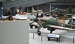 Collection of old fighter airplanes in Warbirds & Wheels museum.jpg