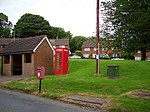 Comms., Knowbury. Phone box, letterbox and shelter for the occasional bus to Ludlow. 30 years ago there was a shop and pub here too. (Still two pubs nearby so not too serious for the locals)