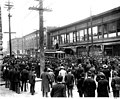 Crowd surrounding streetcar during strike against Seattle Electric Co, in front of Bon Marche, 2nd Ave and Pike St, Seattle (CURTIS 180).jpeg