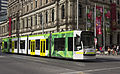 D2 5001 (Melbourne tram) in Elizabeth St on route 19 to City in PTV livery, December 2013.jpg