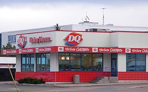 "Dairy Queen - A Dairy Queen store in Moncton, New Brunswick, Canada. Notice the ""Hot Eats, Cool Treats"" slogan near the DQ logo."