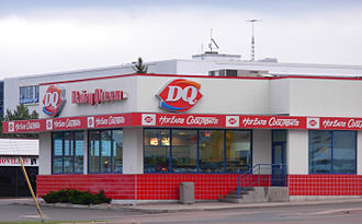 """Dairy Queen - A Dairy Queen store in Moncton, New Brunswick, Canada. Notice the """"Hot Eats, Cool Treats"""" slogan near the DQ logo."""