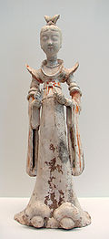 A terracotta sculpture of a lady, 7th-8th century. During the Tang era, female hosts gathered feasts, tea parties, and played drinking games with their guests.