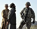 Defense.gov News Photo 101030-F-2558S-074 - U.S. Navy Cmdr. Bill Mallory right commanding officer of the Nuristan Provincial Reconstruction Team listens to a Kautiak village leader in the.jpg