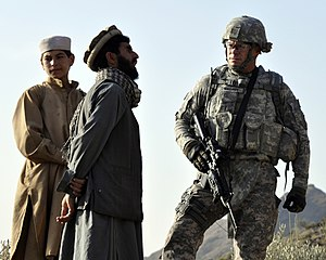 Nuristanis - Kautiak villagers in Nuristan province with U.S. Navy commander (right)