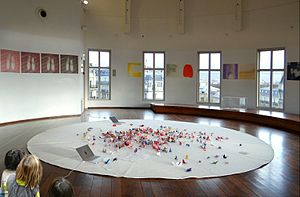 Centre national des arts plastiques - Work from CNAP in the center of the rotunda of the Musée Guimet in 2012. Participatory work on the floor by Marie-Ange Guilleminot (1999), swatches on the wall by Michael Woolworth (2003).