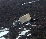 Destroyed Radio Repeater on Dumpling Mountain (2) (12291848425).jpg