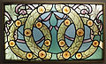 Detail of a window with wreaths of roses, c 1910.jpg