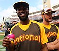 Dexter Fowler poses with a magenta baseball during the T-Mobile -HRDerby. (28542749016).jpg