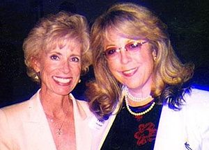 "Laura Schlessinger - Schlessinger with Nikki Hornsby in 2009. Schlessinger used Hornsby's song ""Hot Talkin' Big Shot"" for several years as theme music"