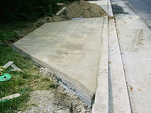 Driveway - Driveway apron and sloped curb to a public street, all under construction