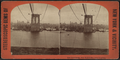 East River bridge, New York Lower, from Broadway, from Robert N. Dennis collection of stereoscopic views.png