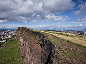 Holyrood Park - View down over the crags, with walkers on the Radical Road.
