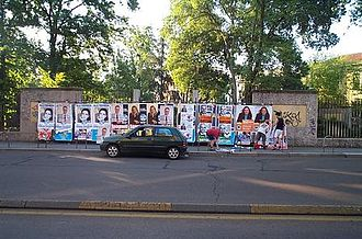 Election - Campaigners working on posters in Milan, Italy, 2004