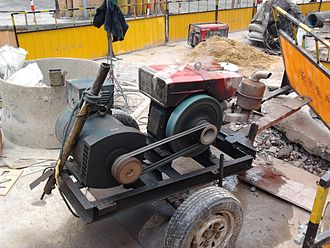 Engine-generator - Cart-mounted engine-generator being used at a construction site