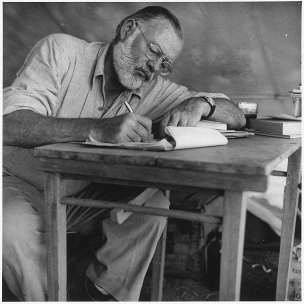 File:Ernest Hemingway Writing at Campsite in Kenya - NARA - 192655.jpg