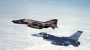 Ramstein Air Base - McDonnell Douglas F-4E-55-MC Phantom II, AF Ser. No. 68-0517, and General Dynamics F-16C Block 25E Fighting Falcon, AF Ser. No. 84–0296 of the 526th TFS/86th TFW, flying in formation, 1985.