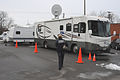 FEMA - 34448 - FEMA employee walking to the FEMA Mobile Disaster Recovery Center (MDRC) at Cynthiana, JY.jpg