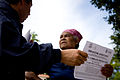 FEMA - 39109 - Resident reads a disaster assistance flier in Puerto Rico.jpg